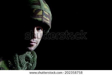 British Soldier Portrait In Shadow - stock photo