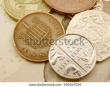 British Sterling pound currency - legal tender of the United Kingdom - banknotes and coins - stock photo
