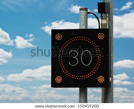 British traffic calming sign which flashes a drivers speed at them if they are in breach of the legal limit in order to reduce there velocity - stock photo