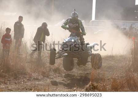 BRITS, SOUTH AFRICA - July 11:  Africa-Offroad Racing Rally,  on July 11, 2015 at Koster, North West Province, South Africa.  Quad Bike airborne over hump.
