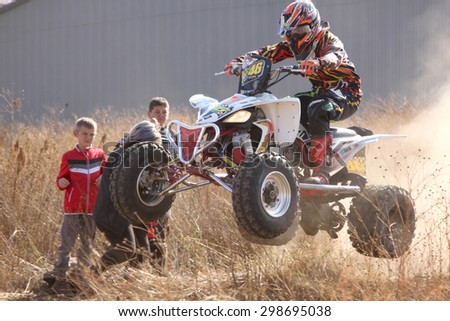 BRITS, SOUTH AFRICA - July 11:  Africa-Offroad Racing Rally,  on July 11, 2015 at Koster, North West Province, South Africa.  Quad Bike airborne over hump. - stock photo