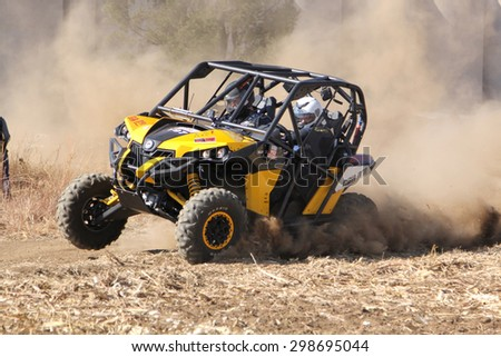 BRITS, SOUTH AFRICA - July 11:  Africa-Offroad Racing Rally,  on July 11, 2015 at Koster, North West Province, South Africa.  Custom twin seater rally buggy kicking up trail of dust.