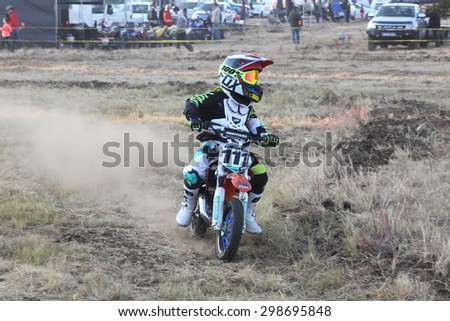 BRITS, SOUTH AFRICA - July 11:  Africa-Offroad Racing Rally,  on July 11, 2015 at Koster, North West Province, South Africa.  Kiddy motorbike rider speeding down track on mini motorbike.  - stock photo