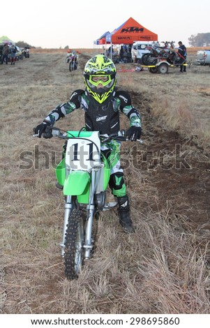 BRITS, SOUTH AFRICA - July 11:  Africa-Offroad Racing Rally,  on July 11, 2015 at Koster, North West Province, South Africa.  Junior motorbike rider posing on motorbike.  - stock photo