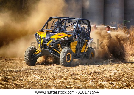 BRITS, SOUTH AFRICA - July 11:  Africa-Offroad Racing Rally,  on July 11, 2015 at Koster, North West Province, South Africa.  HD - Custom twin seater rally buggy kicking up trail of dust on sand track - stock photo