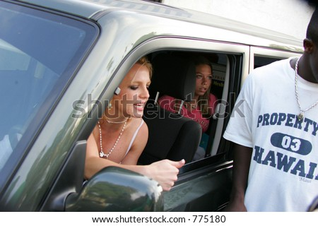 Brittany spears yelling a mother to get back in car after running of photographer