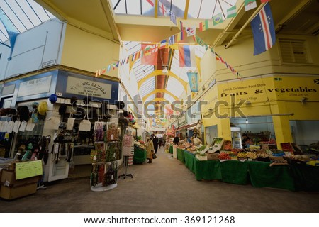 BRIXTON, LONDON, UNITED KINGDOM- January 28, 2016: Interior of market in Brixton which is unique colorful, multicultural area in South London famous by market, music, nightlife... - stock photo