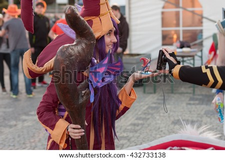 BRNO, CZECH REPUBLIC - APRIL 30, 2016: Cosplayer dressed as character Lulu from game League of Legends poses  at Animefest on April 30, 2016 Brno, Czech Republic  - stock photo