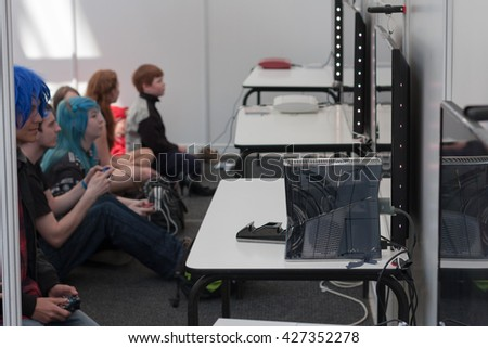 BRNO, CZECH REPUBLIC - APRIL 30, 2016: Unidentified teenagers playing console games at Animefest, anime and manga convention on April 30, 2016 Brno in the Czech Republic