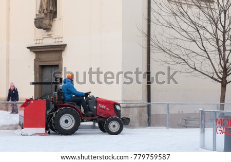 Brno,Czech Republic-December 18,2017: Man in tractor cleans artificial ice rink on Moravian Square on December 18, 2017 Brno, Czech Republic