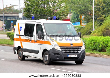 BRNO, CZECH REPUBLIC - JULY 22, 2014: Ambulance car Renault Master at the city street. - stock photo