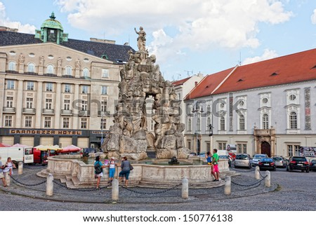 BRNO, CZECH REPUBLIC - JULY, 30: Tourists on  area the Cabbage market at  fountain Parnassus, Brno, Czech Republic, July, 30, 2013. Second-large city of Czech Republic and the largest city of Moravia - stock photo
