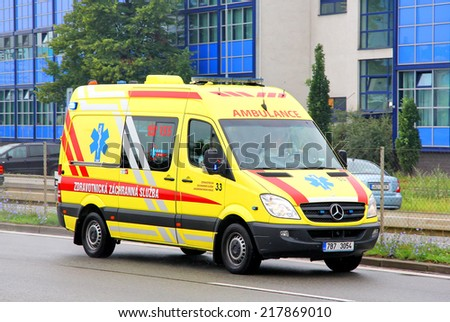 BRNO, CZECH REPUBLIC - JULY 22, 2014: Yellow ambulance car Mercedes-Benz Sprinter at the city street. - stock photo