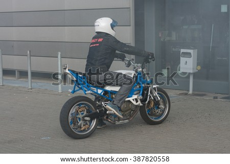 BRNO, CZECH REPUBLIC-MARCH 4,2016: Stuntman riding a motorcycle before starting stunt show on International Fair for Motorcycles  on March 4,2016 in Brno in Czech Republic