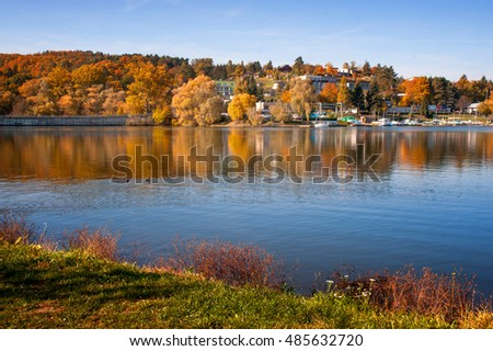 Brno lake in autumn sunny day with beautiful reflections in water