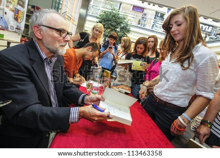 BRNO - SEPTEMBER 14: C.D. Payne (L) at a book signing of his book Invisible yours and Son of Youth in Revolt: Diaries of Scott Twisp 14th September 2012, Brno, Czech Republic. - stock photo