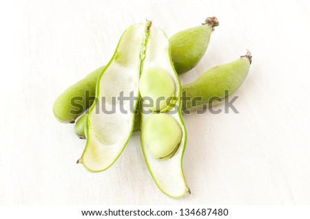 broad beans in a pod on a white background - stock photo