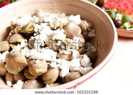 Broad beans with pecorino cheese - stock photo