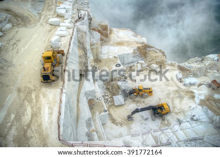 Broad view of the process in the white marble quarries in Carrara Italy - stock photo