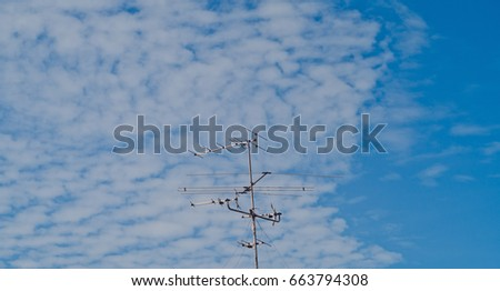 Broadcast pole with blue sky