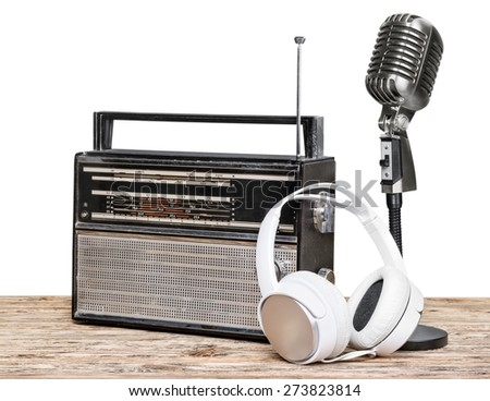 Broadcasting. Retro radio and cassette player, microphone, headphones on table - stock photo