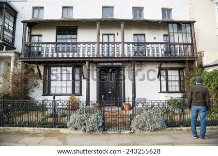 BROADSTAIRS, UK - JAN 7, 2015. A tourist stands outside the Dickens House Museum. It is housed in the cottage that was Charles Dickens inspiration for the home of Betsey Trotwood in David Copperfield. - stock photo