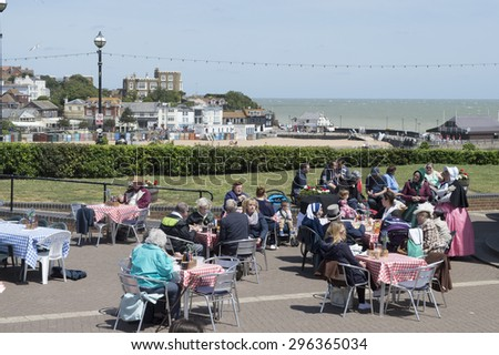 BROADSTAIRS,UK-JUNE 15: Visitors enjoy refreshments during the annual Victorian Dickens Festival that attracts thousands of visitors each year. June 15, 2015, Broadstairs, Kent, UK - stock photo