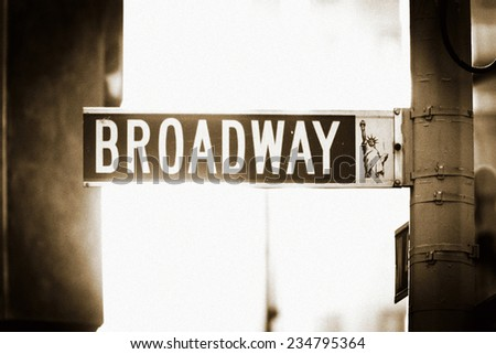 Broadway Street Sign in New York City, with Statue of Liberty  - stock photo