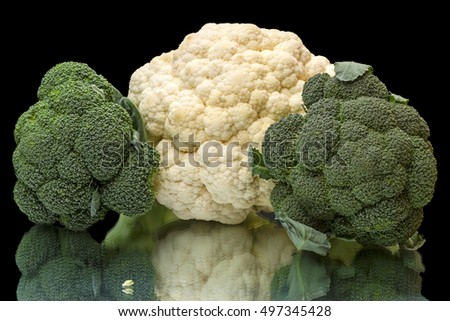 Broccoli and cauliflower isolated on a black background