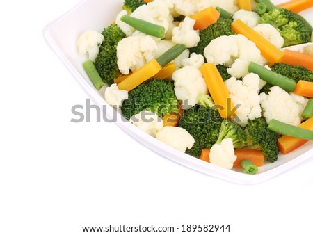 Broccoli and cauliflower salad. Isolated on a white background. - stock photo