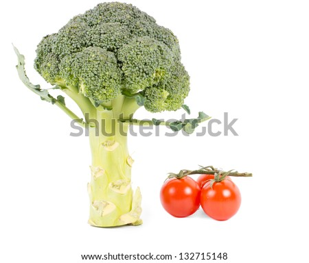 Broccoli and fresh tomatoes on vine, on white background - stock photo