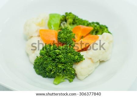 Broccoli, cauliflower and carrots - stock photo