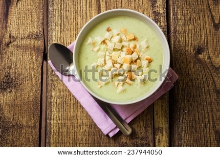 Broccoli cream soup and dried crusts, top view - stock photo