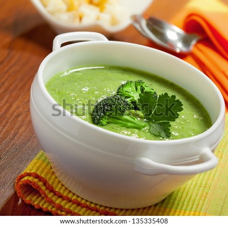 Broccoli cream soup on table - stock photo