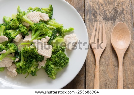 Broccoli Fried in wooden background. - stock photo