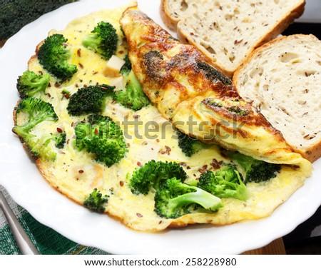 Broccoli omellete. Breakfast - stock photo