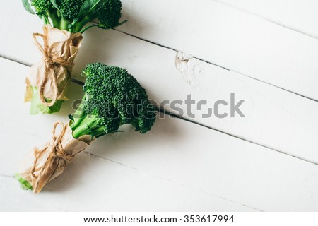 Broccoli on a wooden table - stock photo