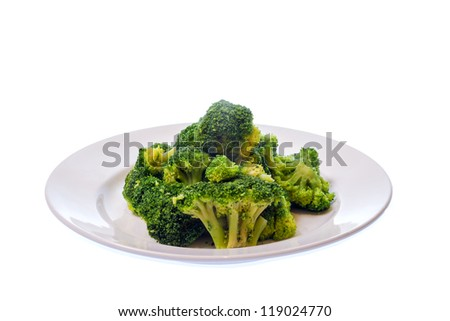 Broccoli on plate isolated on white - stock photo