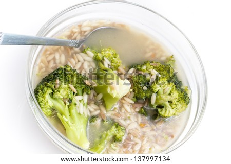 broccoli soup in glass bowl - stock photo