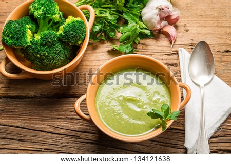 Broccoli soup made of fresh vegetables, garlic and parsley - stock photo