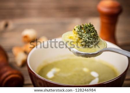 Broccoli soup on bowl, close up shot - stock photo
