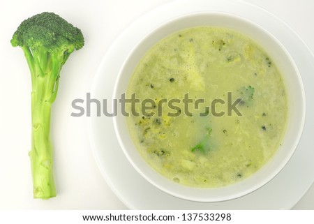 Broccoli soup on bowl over a blurry background - stock photo