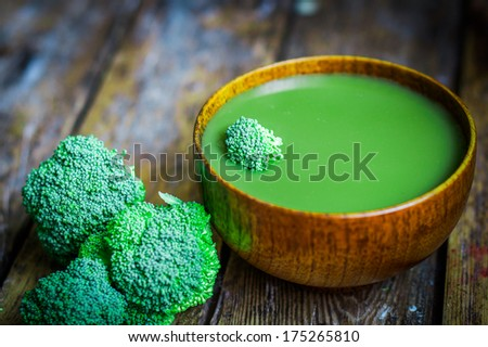 Broccoli soup on wooden background - stock photo