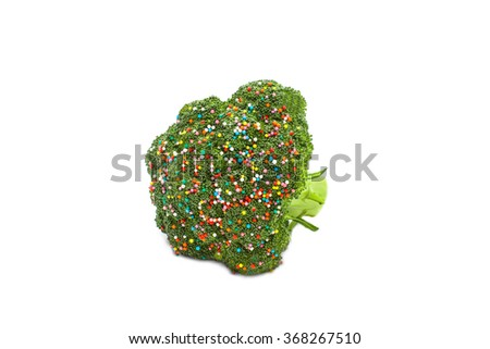 broccoli sprinkled with colorful sugar sprinkles. Fancy a dish of broccoli cabbage with multicolored sugar sprinkle dots. metaphor of wishful thinking. food porn concept. Isolated on white background - stock photo
