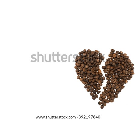 Brocken heart made of roasted coffee beans on white backgroud
