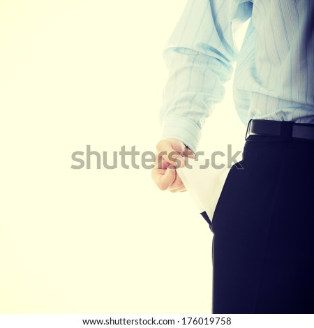 Broke business man with empty pockets - stock photo