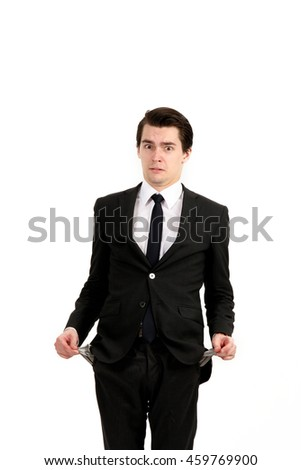 Broke businessman with empty pockets. Closeup side view profile portrait of upset young man, worker, employee, business man hands in pockets, open mouth yelling isolated on white background