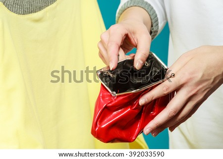 Broke human hands holding empty wallet purse. Lack of money for fashion clothes. Crisis and weak economy concept. - stock photo