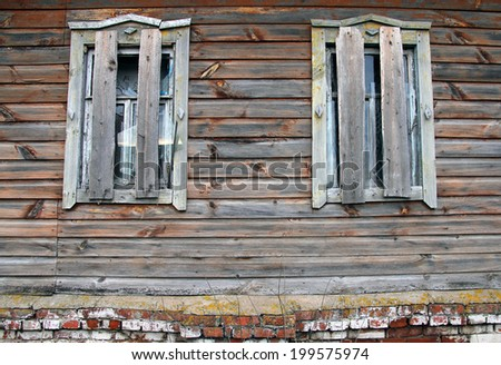 Broken And boarded windows of an old abandoned farmhouse - stock photo