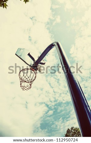 broken basket ball board under blue sky with clouds - stock photo
